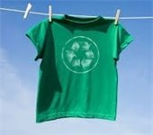 Green t-shirt with recycling symbol hanging on clothesline