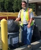 Lebanon Solid Waste Manager Marc Morgan standing by display