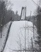 photo of ski jumper coming off the Storrs Hill ski jump
