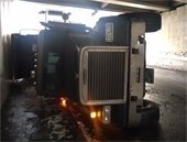 Truck turned on its side under I89 bridge.