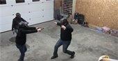 three people in black hoodies reenacting an active shooter scene
