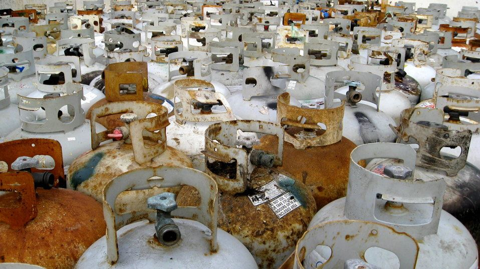 a collection of propane tanks sitting in a collection area