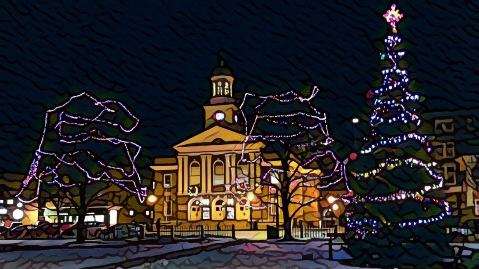 City Hall at night with holiday lights Opens in new window