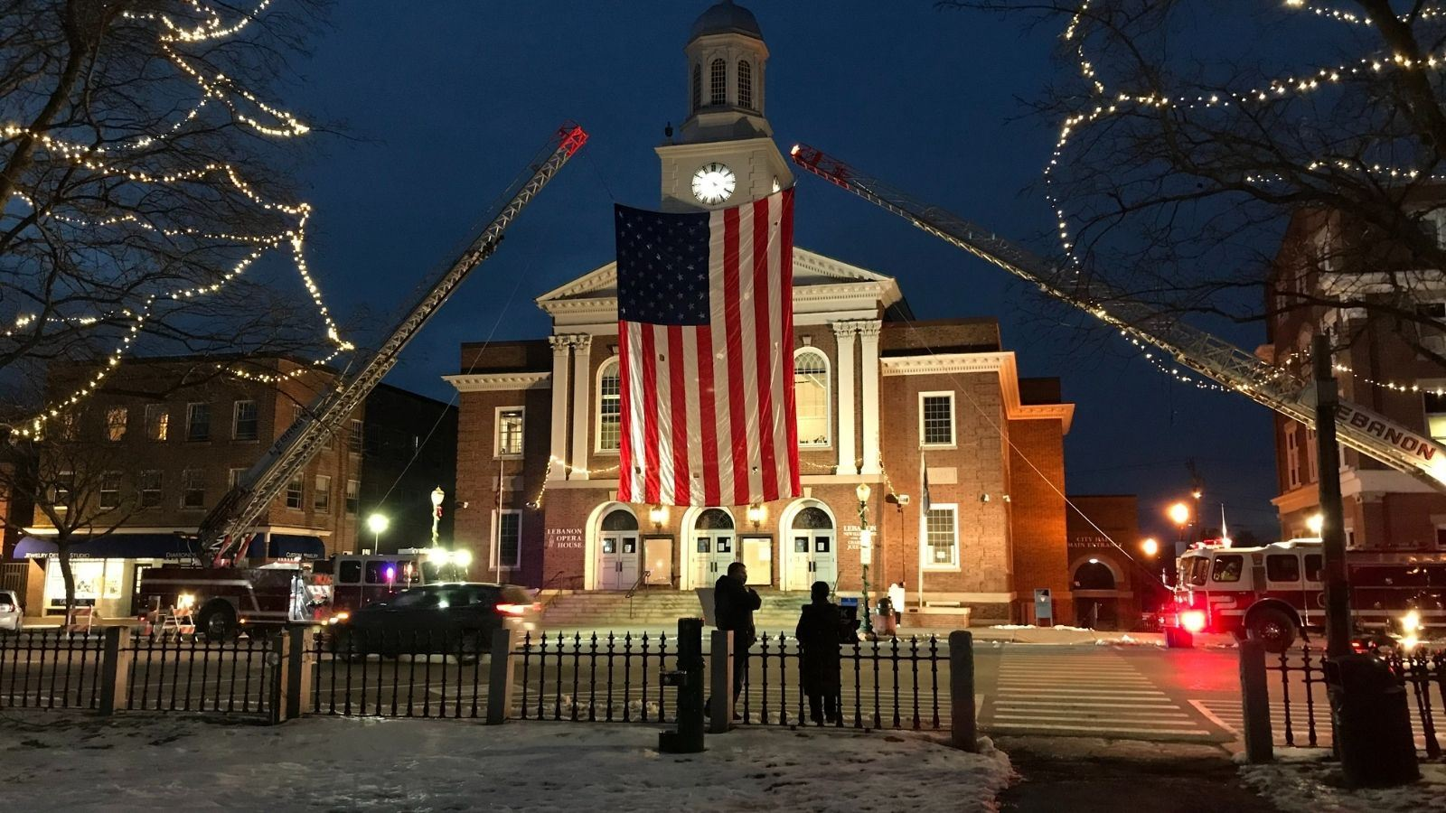U.S. flag hanging in front of City Hall as part of COVID-19 Vigil