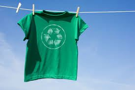 Green T-shirt with recycling symbol hanging on clothes line