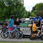 Officers Assisting Children on Bikes