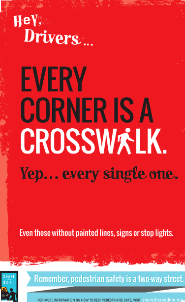 red sign that says every corner is a crosswalk
