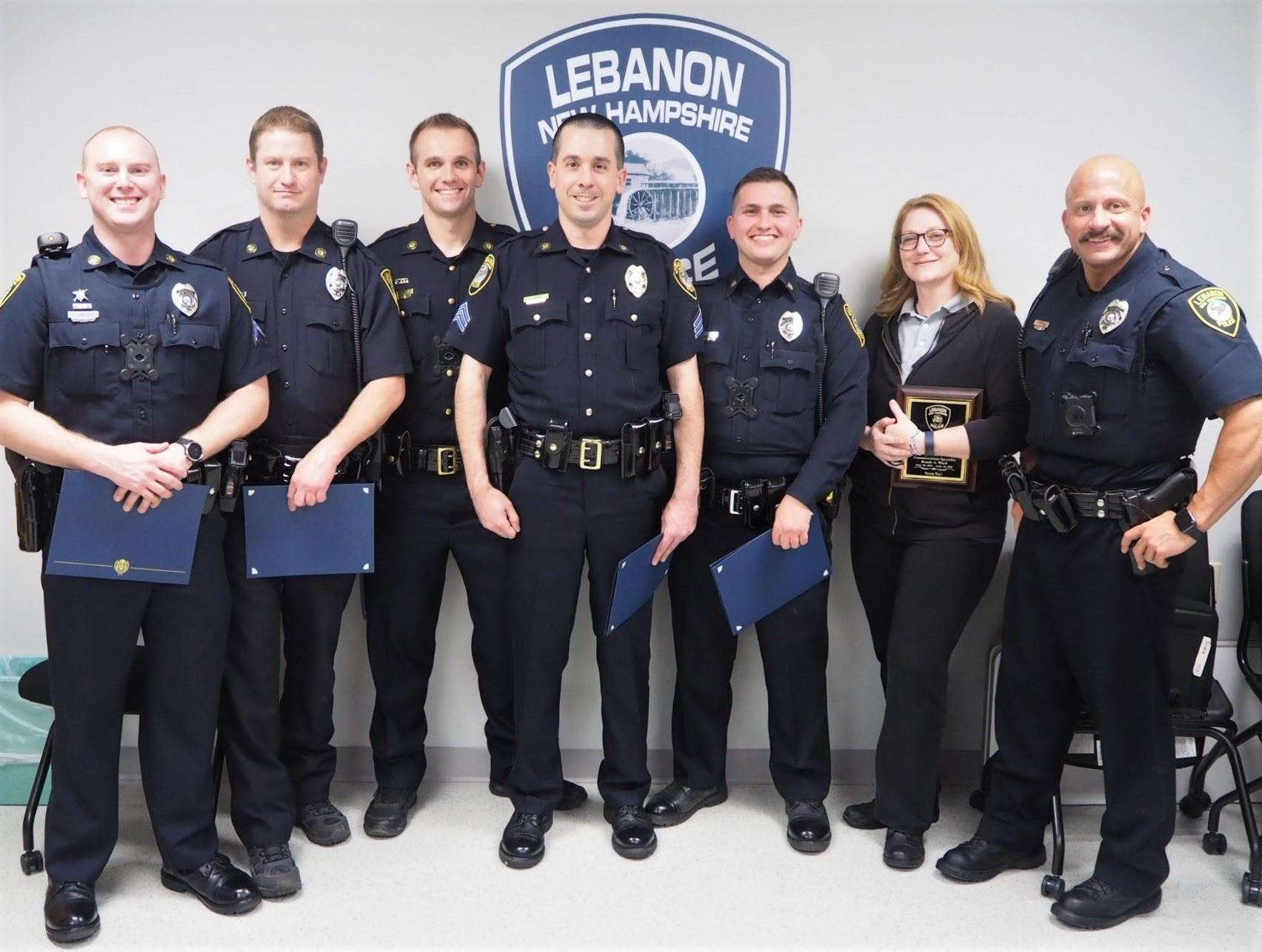 Group photo of several officers and dispatcher