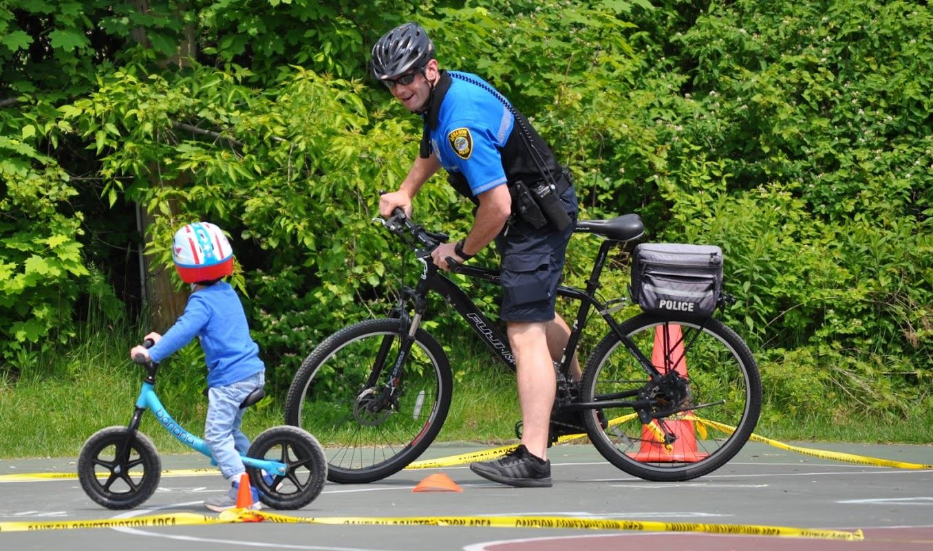 Corporal Hubert with child on bike2