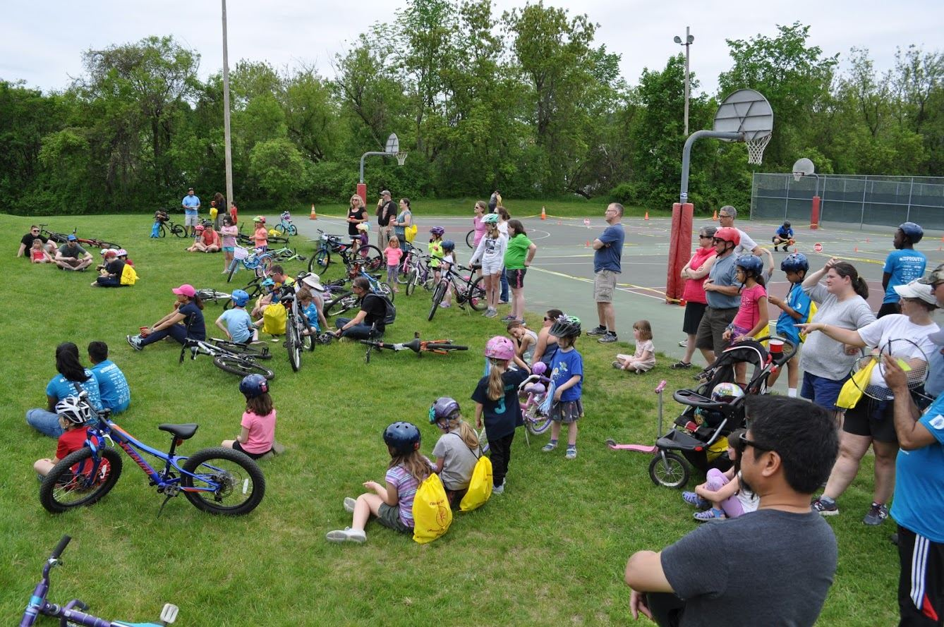 Group of people gathered at the bike rodeo