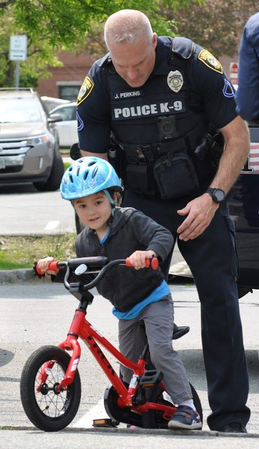 Officer Perkins with child on bike