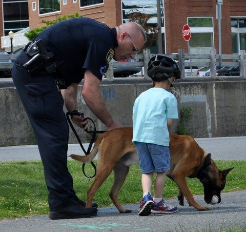 Officer and K-9 Walking with Child